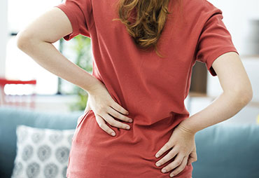 Woman with intense lower back pain
