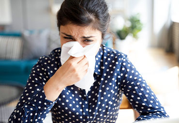 Woman suffering with severe allergies