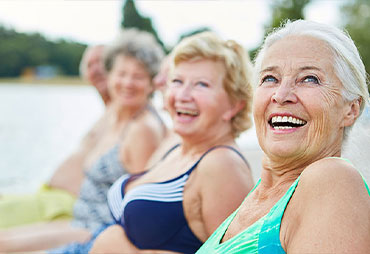 Mature women enjoying leisure sports together in the summer to stay healthy
