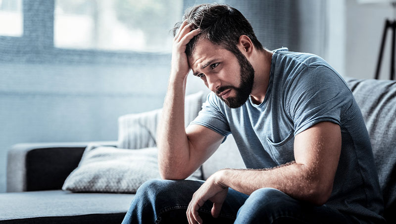 Man struggling with stress at home