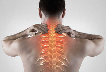 man with upper back and neck pain