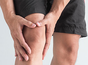 Man suffering with from knee pain